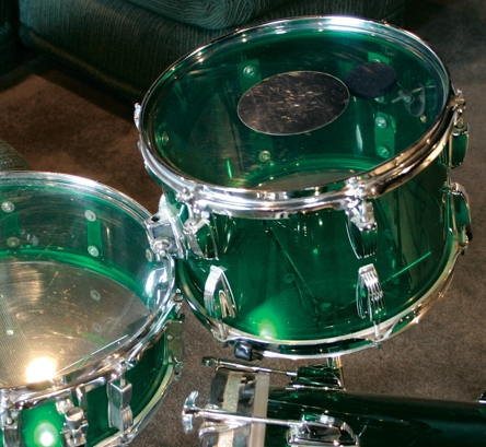 Fig. 2 Silver dot head on Ludwig Vistalite kit. Note the internal felt muffler visible to the right of dot.